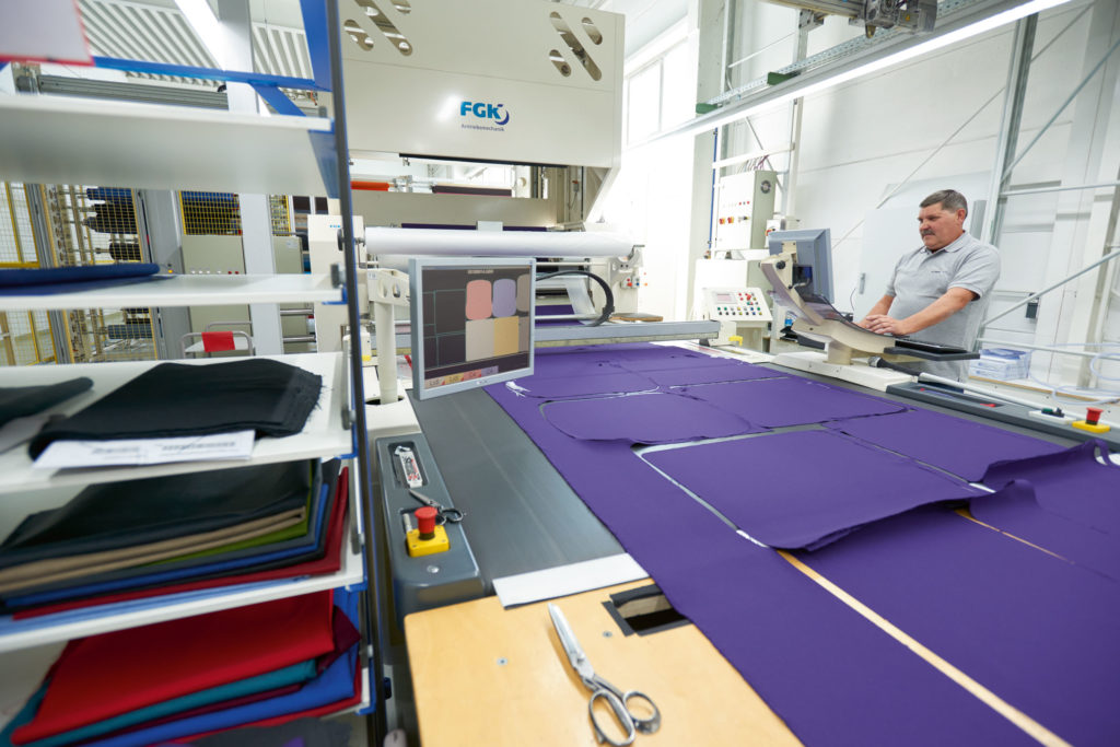 The cutter cuts the different upholstery fabrics to size.